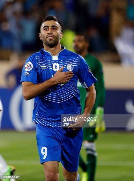 Esteghlal's Kaveh Rezaie celebrates after scoring during the 2017 AFC Champions League round 16 football match between Iran's Estehlal FC and UAE's...