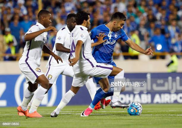 Esteghlal's Kaveh Rezaie fights for the ball agaisn alAin's Salem Juma during the 2017 AFC Champions League round 16 football match between Iran's...