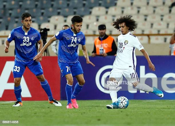 Esteghlal's Mojtaba Haghdust fights for the ball agaisn alAin's Omar Abdulrahman during the 2017 AFC Champions League round 16 football match between...