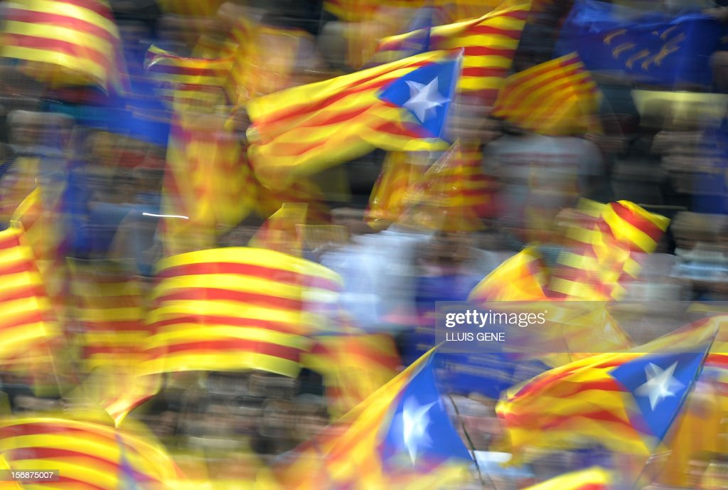 Estelada and Catalan flags are waves during a final meeting of Artur Mas, current President of Catalonia and leader of the CiU (Catalan Convergence and Unity party), for his re-election campaign on November 23, 2012, in Barcelona. Artur Mas is seeking re-election in the upcoming Catalonia regional elections on November 25 and promised voters a referendum on the 'independance' and 'auto-determination' of the region if he wins a new mandate. AFP PHOTO/ LLUIS GENE