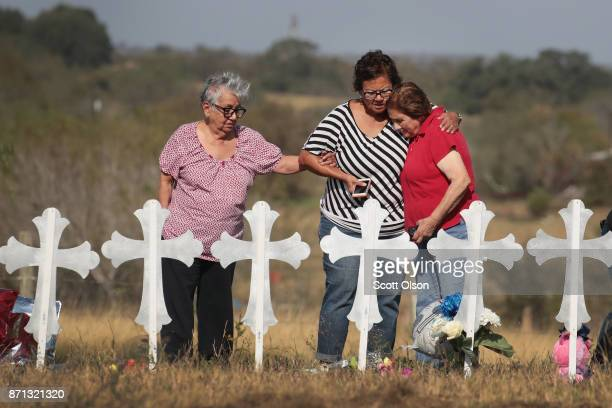 Estella McAteer her daughter Diana Gaitan and Maria Durand visit a memorial where 26 crosses stand in a field on the edge of town to honor the 26...