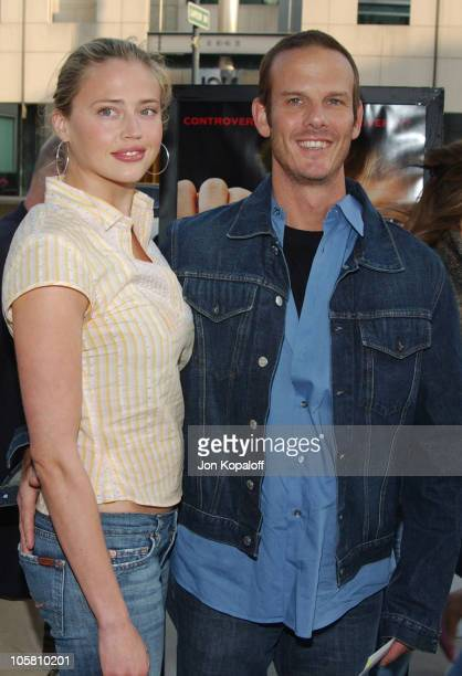 Estella Warren and Peter Berg during 'Fahrenheit 9/11' Special Screening 1 Arrivals at Academy of Motion Picture Arts and Science in Beverly Hills...