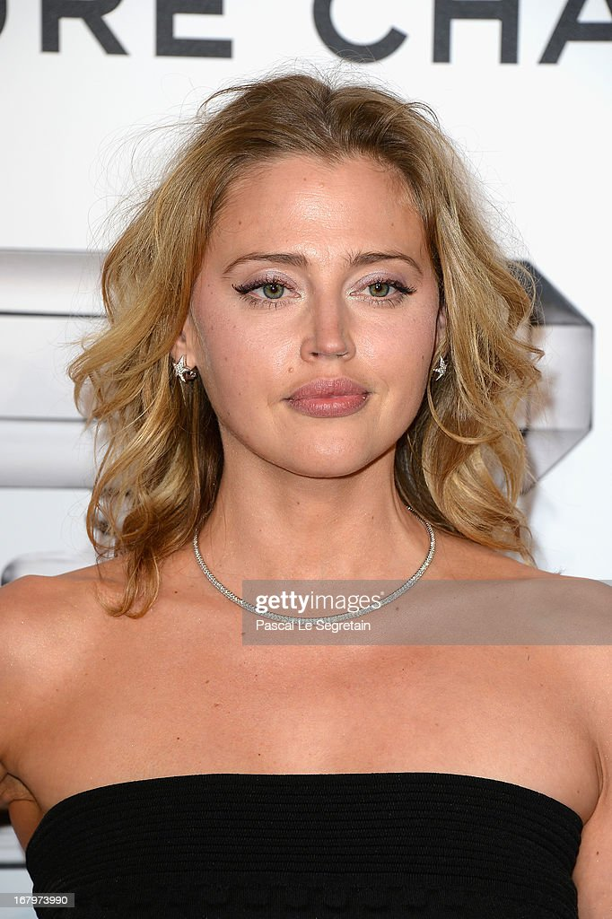 Estella Warren poses during a photocall for 'N°5 Culture Chanel' exhibition at Palais De Tokyo on May 3, 2013 in Paris, France.
