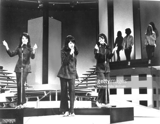 Estelle Bennett Vann Ronnie Spector and Nedra Talley Ross of the vocal trio 'Ronettes' perform onstage in circa 1965