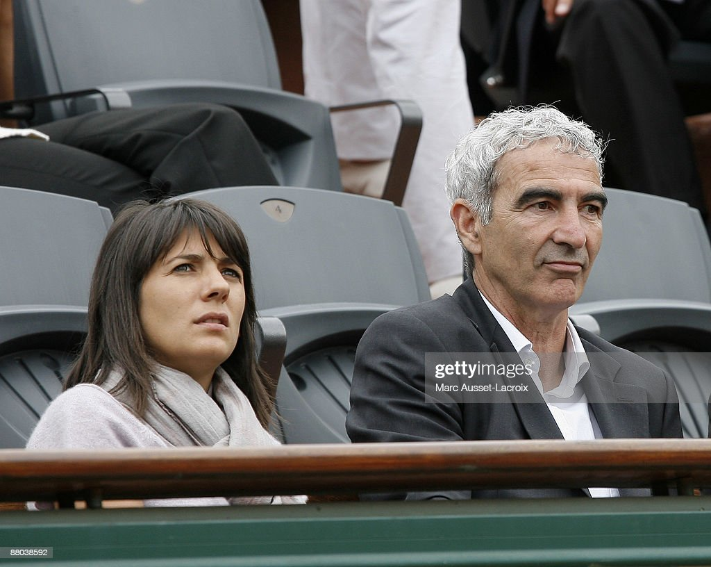 Estelle Denis and Raymond Domenech attend the second round match between Switzerland's Roger Federer and Argentina's Jose Acasuso at the French Open tennis tournament at the Roland Garros stadium on May 28, 2009 in Paris, France.