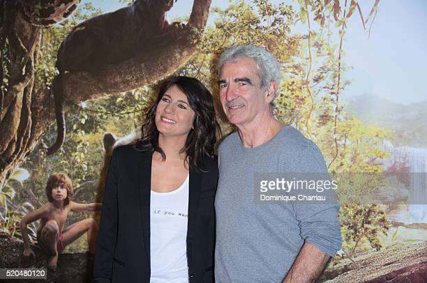 Estelle Denis and Raymond Domenech attend the 'The Jungle Book' Paris Premiere at Cinema Pathe Beaugrenelle on April 11 2016 in Paris France