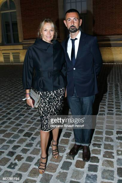 Estelle Lefebure and editor Guillaume Robert attend the 'Diner Surrealiste' to celebrate the 241th birthday of 'Maison Louis Roederer' on October 4...