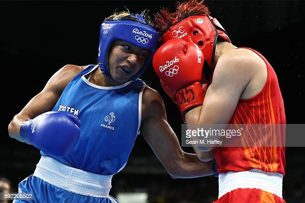 Estelle Mossely of France fights Junhua Yin of China in the Women's Light Final Bout on Day 14 of the Rio 2016 Olympic Games at the Riocentro arena...