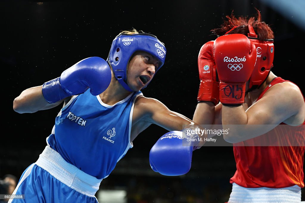 Estelle Mossely of France fights Junhua Yin of China in the Women's Light Final Bout on Day 14 of the Rio 2016 Olympic Games at the Riocentro arena on August 19, 2016 in Rio de Janeiro, Brazil.