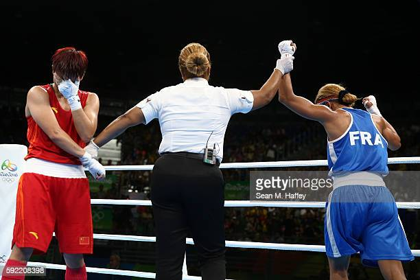 Estelle Mossely of France reacts after defeating Junhua Yin of China in the Women's Light Final Bout on Day 14 of the Rio 2016 Olympic Games at the...