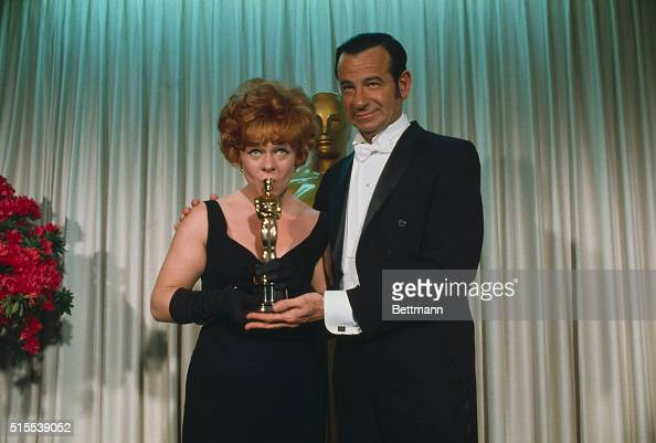 Estelle Parsons is shown with Walter Matthau who presented her with an Oscar for Best supporting Actress during the annual Academy Awards...