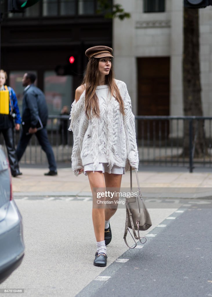 Estelle Pigault wearing a white knit, Chloe bag, slippers, socks, flat cap during London Fashion Week September 2017 outside Eudon Choi on September 15, 2017 in London, England.