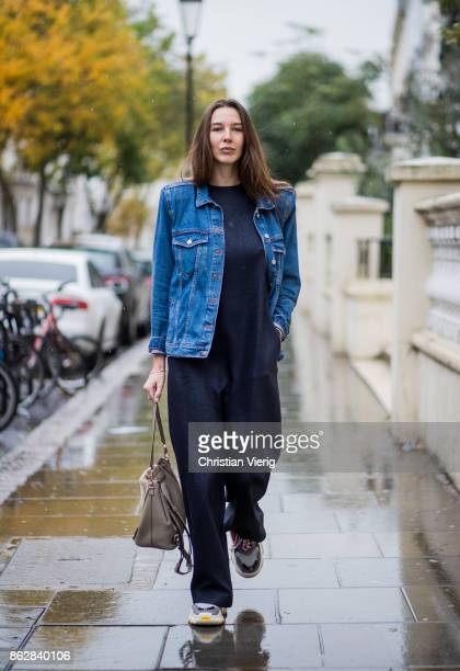 Estelle Pigault wearing Bershka denim jacket with strong shoulderss navy overall Esau Yori Chloe backpack Balenciaga Triple S sneakres on October 18...