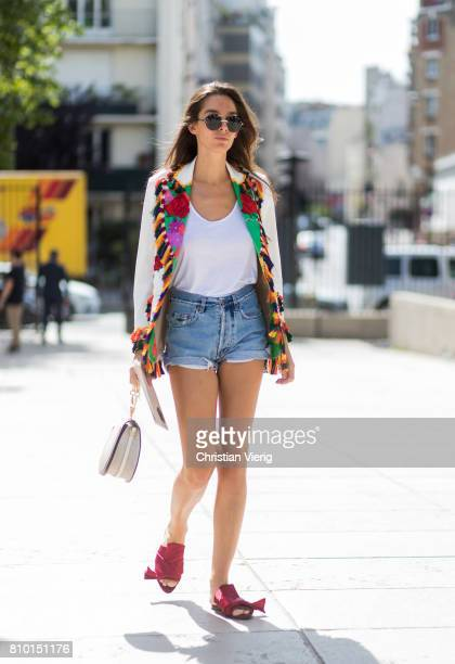 Estelle Pigault wearing blazer denim shorts Chloe bag outside Viktor Rolf during Paris Fashion Week Haute Couture Fall/Winter 20172018 Day Four on...