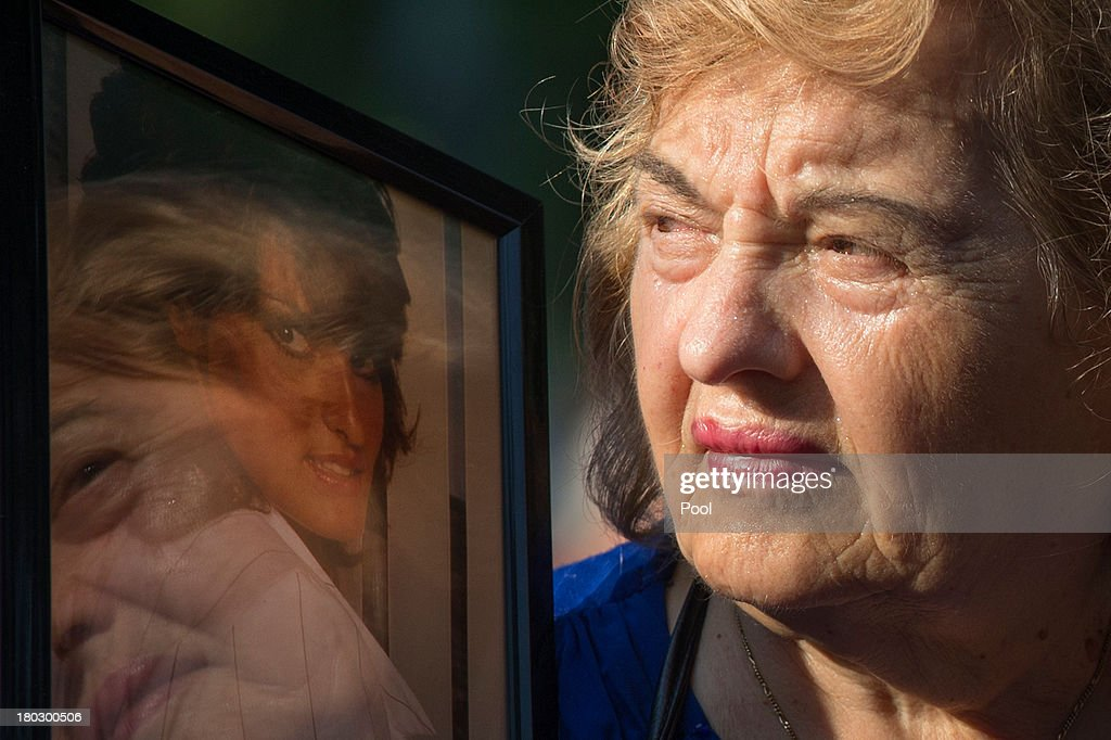 Ester DiNardo, mother of Marisa DiNardo, clutches her image while attending the 9/11 Memorial ceremonies marking the 12th anniversary of the 9/11 attacks on the World Trade Center on September 11, 2013 in New York City. The nation is commemorating the anniversary of the 2001 attacks which resulted in the deaths of nearly 3,000 people after two hijacked planes crashed into the World Trade Center, one into the Pentagon in Arlington, Virginia and one crash landed in Shanksville, Pennsylvania. Following the attacks in New York, the former location of the Twin Towers has been turned into the National September 11 Memorial & Museum.