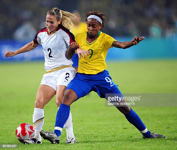 Ester of Brazil vies for the ball against Heather Mitts of US during the 2008 Beijing Olympic Games women's football Gold medal match at the Workers...