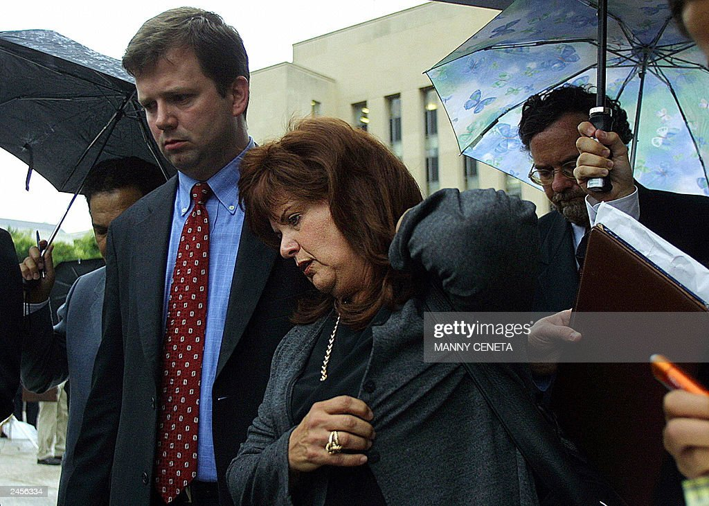 Ester Pollard (C), wife of convicted spy Jonathan Pollard, is escorted by James E. Haggerty (L) and Pollard supporters as they leave the US District Court (background) 02 September, 2003 in Washington, DC. Pollard, sentenced to life in prison for spying for Israel in 1987, returned to the the same courthouse as another judge considers procedural matters in Pollard's long campaign to reduce his sentence. AFP PHOTO/Manny CENETA