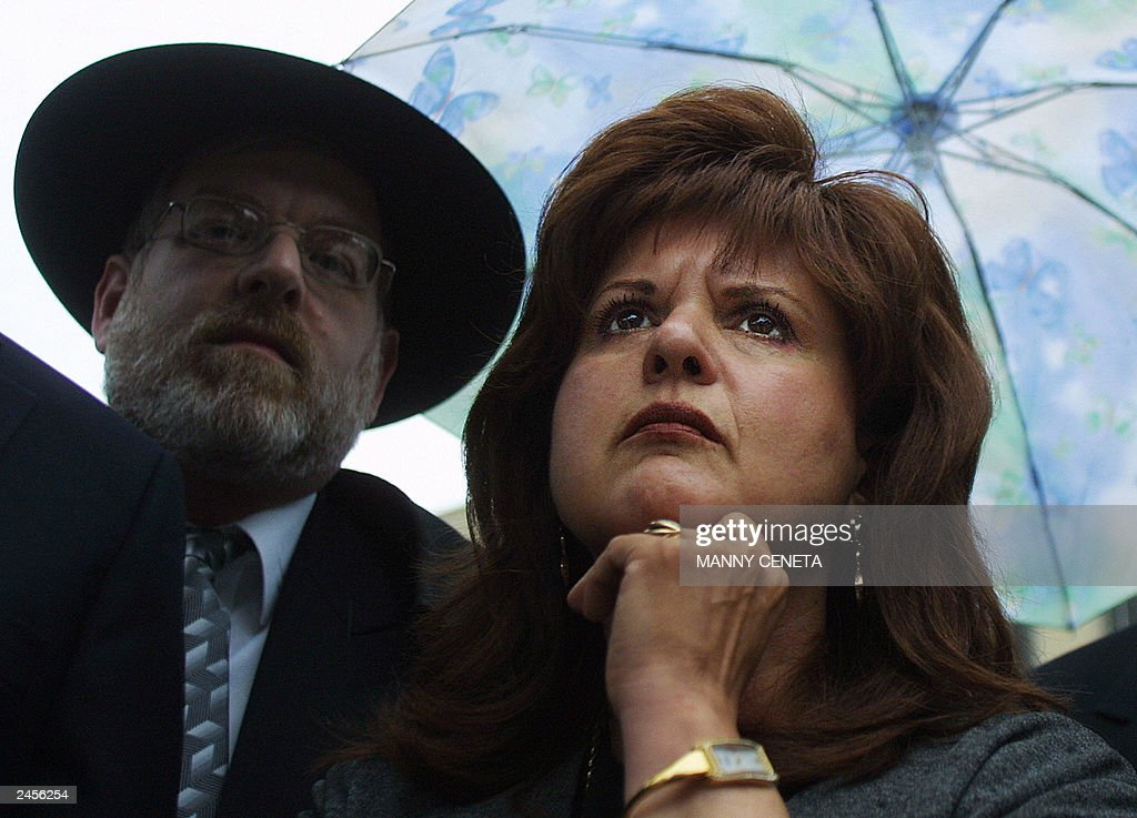 Ester Pollard (R), wife of convicted spy Jonathan Pollard, listens to her husband's lawyer talk to the press outside the US District Court 02 September, 2003, in Washington, DC. Pollard sentenced to life in prison for spying for Israel in 1987 returned to the the same courthouse as another judge considers procedural matters in Pollard's long campaign to reduce his sentence. Man on the left is an unidentified Pollard supporter. AFP PHOTO/Manny CENETA