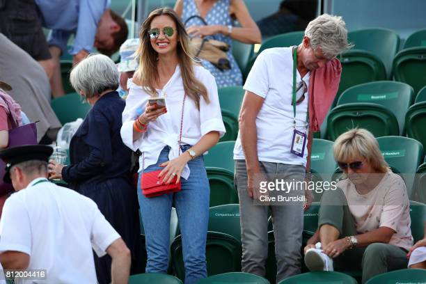 Ester Satorova wife of Tomas Berdych and his father Martin Berdych look on after his Gentlemen's Singles fourth round match victory against Dominic...