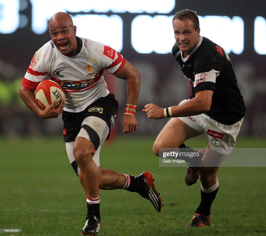 JR Esterhuizen gets past Meyer Bosman during the Absa Currie Cup match between The Sharks and MTN Golden Lions at Mr Price Kings Park on August 18, 2012 in Durban, South Africa