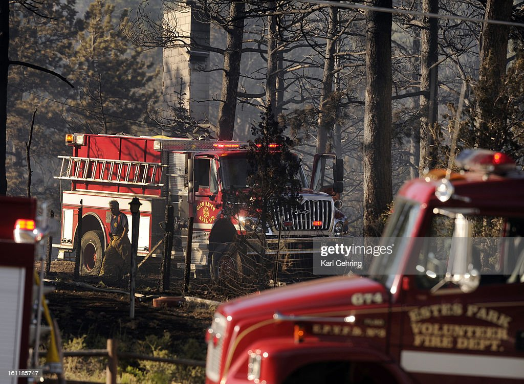 Estes Park Volunteer Fire Department firefighters continued to work at the Woodland Heights fire in Estes Park late Saturday evening An estimated 22...