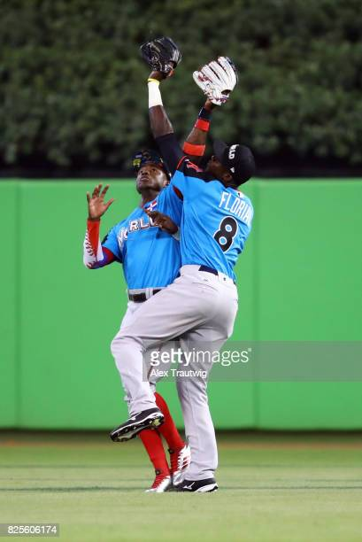 Estevan Florial of the World Team makes the catch over teammate Victor Robles during the SirusXM AllStar Futures Game at Marlins Park on Sunday July...