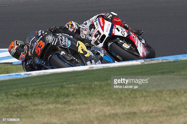 Esteve Rabat of Spain and Estrella Galicia 00 Marc VDS leads Danilo Petrucci of Italy and Octo Pramac Racing during the 2016 MotoGP Test Day at...