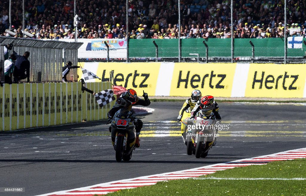 Esteve Rabat of Spain and Marc VDS Racing Team cross the finish line and celebrates victory at the end of the Moto2 race during the MotoGp Of Great Britain - Race at Silverstone Circuit on August 31, 2014 in Northampton, United Kingdom.