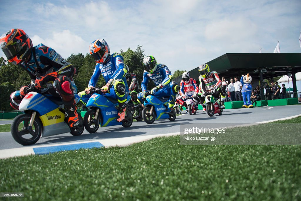 Esteve Rabat of Spain and Team EG 0,0 Marc VDS leads the field and rides the mini-bike during the pre-event 'The mini-battle between the MotoGP riders and children with electric mini bikes at Mobi Park at Motegi' ahead of the MotoGP of Japan at Twin Ring Motegi on October 12, 2017 in Motegi, Japan.