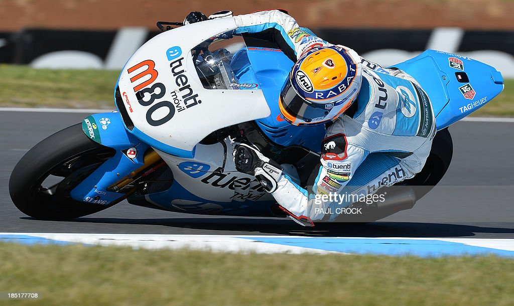 Esteve Rabat of Spain races his Kalex through a corner during practice for the Australian Moto2 Grand Prix at Phillip Island on October 18, 2013. AFP PHOTO/Paul Crock USE