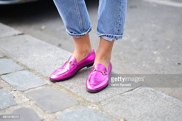 Esthelle Pigault poses wearing Gucci loafers before the Celine show at the Tennis Club de Paris during Paris Fashion Week SS16 on October 4 2015 in...