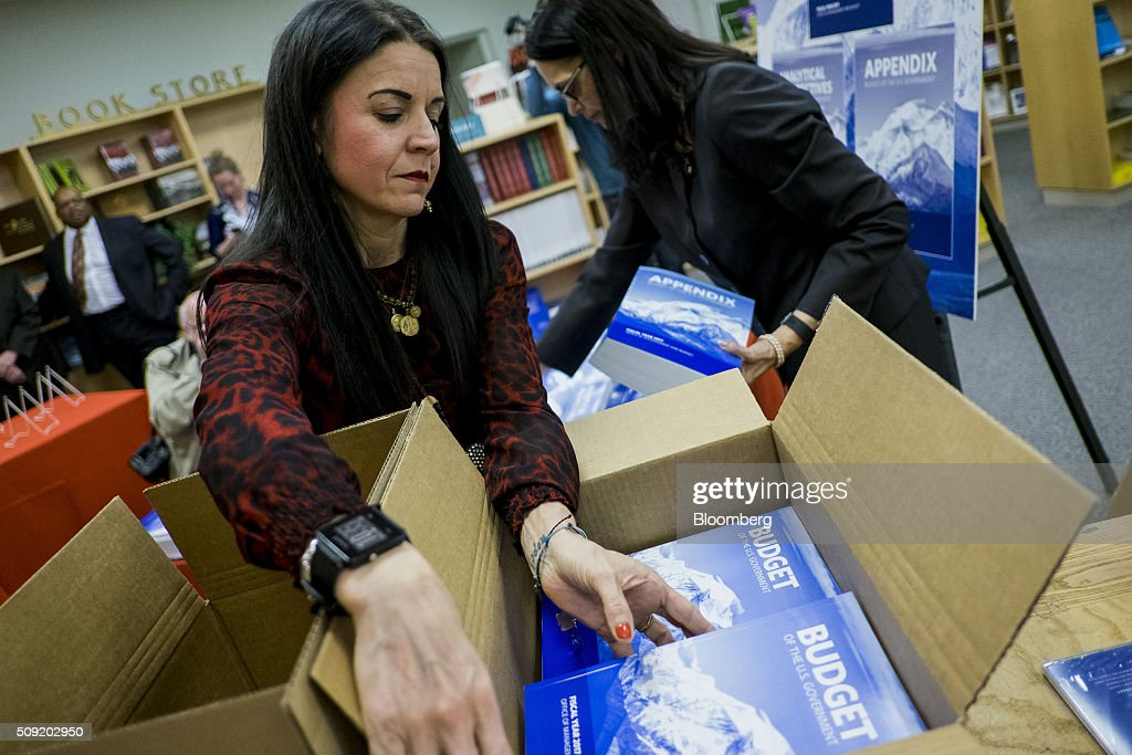 Esther Edmonds, chief of publication and informations sales, right, and Special Events Coordinator BethAnn Telford, both with the Government Printing Office, unpack copies of U.S. President Barack Obama's Fiscal Year 2017 Budget at the Government Publishing Office bookstore in Washington, D.C., U.S., on Tuesday, Feb. 9, 2016. Obama will send a fiscal 2017 budget of about $4 trillion to the Republican-controlled Congress on Tuesday representing his aspirations for the future of the U.S. Photographer: Pete Marovich/Bloomberg via Getty Images