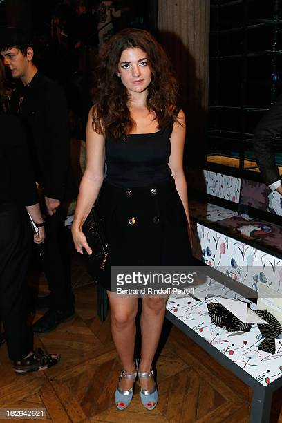 Esther Garrel attends the Miu Miu show as part of the Paris Fashion Week Womenswear Spring/Summer 2014 at the Palais d'IENA on October 2 2013 in...