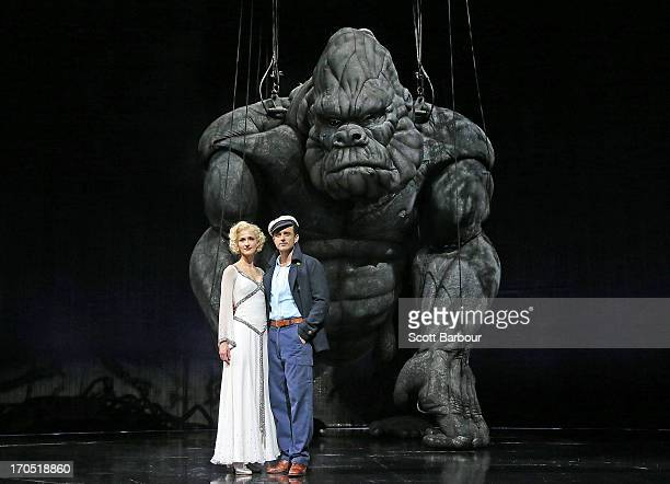 Esther Hannaford who plays Ann Darrow and Chris Ryan who plays Jack Driscoll pose with King Kong on stage during a 'King Kong' production media call...