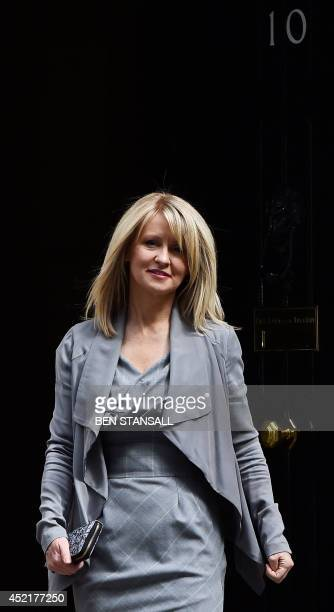 Esther McVey Minister for Employment and Disabilities leaves Downing Street in London on July 15 2014 Britain's Prime Minister David Cameron unveiled...