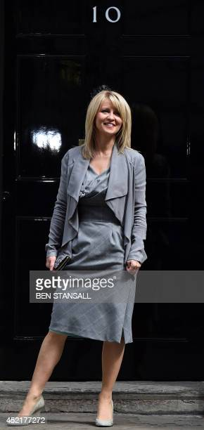 Esther McVey Minister for Employment and Disabilities poses for photogrpahs as she leaves Downing Street in London on July 15 2014 Britain's Prime...