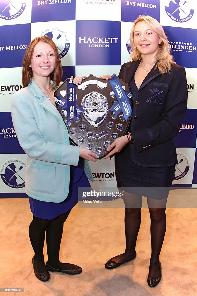 Esther Momcilovic, CUWBC President and Maxie Scheske, OUWBC President for the 2014 Boat Race campaign pose with The Womens Boat Race Trophy during the BNY Melon University Boat Race Autumn Reception at the BNY Melon offices on 24th October 2013 in London, England.