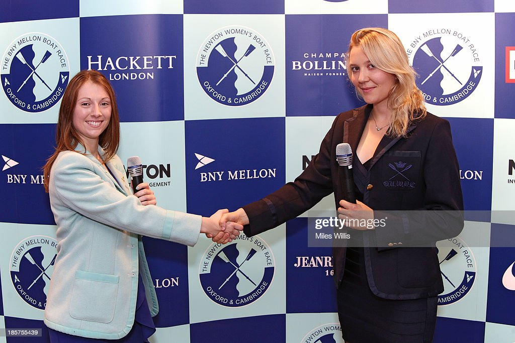 Esther Momcilovic, CUWBC President and Maxie Scheske, OUWBC President for the 2014 Boat Race campaign shake hands after the official challenge during the BNY Melon University Boat Race Autumn Reception at the BNY Melon offices on 24th October 2013 in London, England.