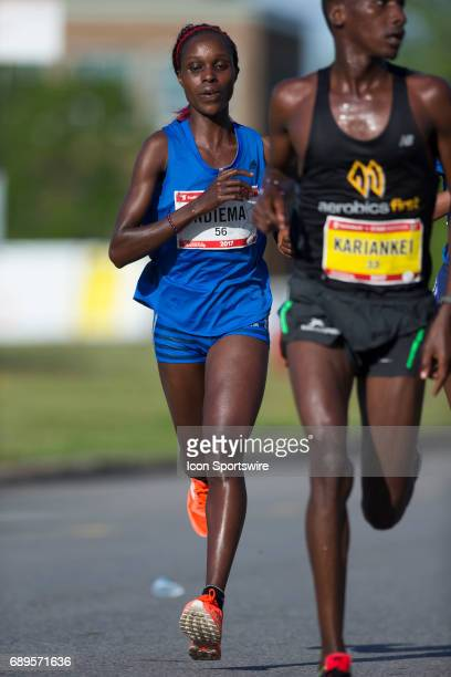 Esther Ndiema of Kenya running to fifth place with a time of 23426 in the Ottawa Marathon road race during the Tamarack Ottawa Race Weekend The...
