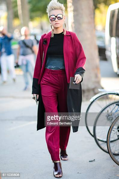 Esther Quek is wearing a red coat red pants and sunglasses outside the Rochas show at the Palais de Tokyo during Paris Fashion Week Spring Summer...
