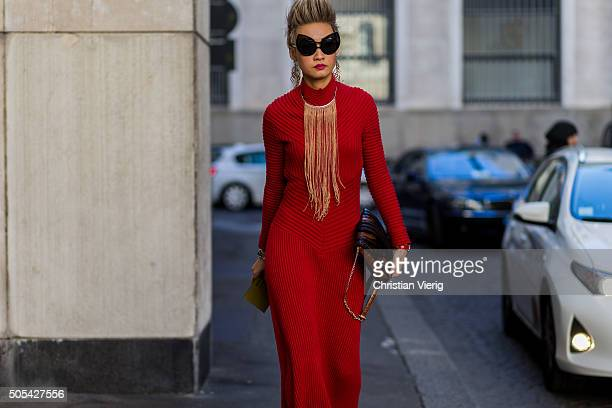 Esther Quek outside Salvatore Ferragamo during Milan Men's Fashion Week Fall/Winter 2016/17 on January 17 in Milan Italy