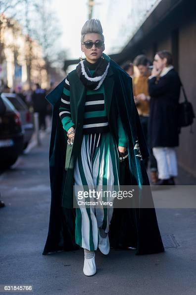 Esther Quek wearing Fendi Elisabetta Franchi and Celine shoes at Etro during Milan Men's Fashion Week Fall/Winter 2017/18 on January 16 2017 in Milan...