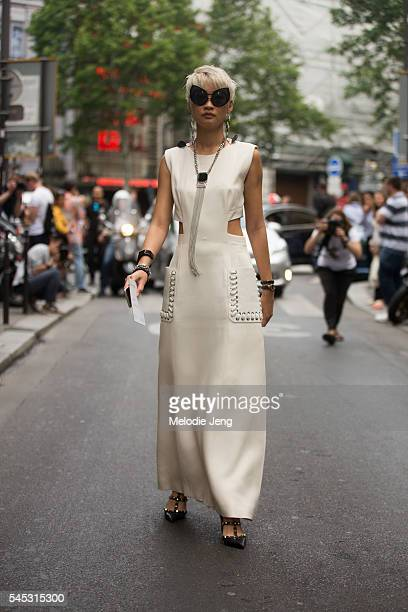 Esther Quek wears a Fendi dress at the Elie Saab show at Pavillon Cambon on July 6 2016 in Paris France