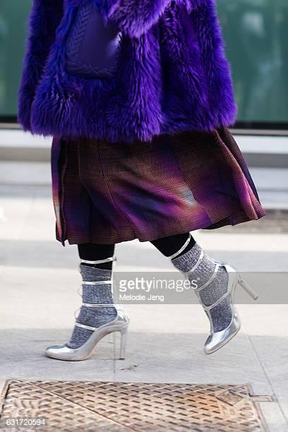 Esther Quek wears a purple Fendi fur coat and silver Jimmy Choo heels during Milan Men's Fashion Week Fall/Winter 2017/18 on January 14 2017 in Milan...