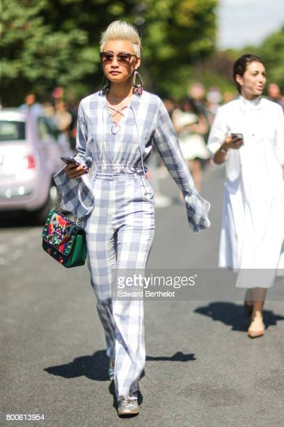 Esther Quek wears sunglasses a gingham full outfit and a multi color bag outside the Dior show during Paris Fashion Week Menswear Spring/Summer 2018...