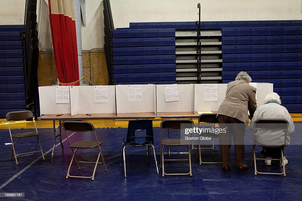 Esther Theodore, left, 88, and Edna Flanagan, 96, fill out voter ballots at Memorial High School in Manchester, New Hampshire on Election Day, November 6, 2012.