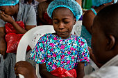 Esther Tokpah 11 an orphan weeps as Dr Jerry Brown tries to console her before she was released from care on Wednesday September 24 2014 in Monrovia...