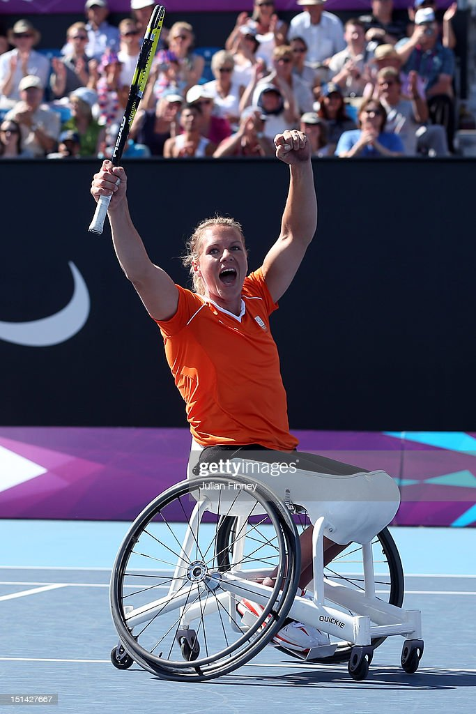 <a gi-track='captionPersonalityLinkClicked' href=/galleries/search?phrase=Esther+Vergeer&family=editorial&specificpeople=622149 ng-click='$event.stopPropagation()'>Esther Vergeer</a> of Netherlands celebrates defeating Aniek Van Koot of Netherlands in the final of the Women's singles match in the Wheelchair Tennis on day 9 of the London 2012 Paralympic Games at Eton Manor on September 7, 2012 in London, England.