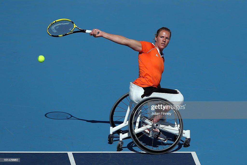 <a gi-track='captionPersonalityLinkClicked' href=/galleries/search?phrase=Esther+Vergeer&family=editorial&specificpeople=622149 ng-click='$event.stopPropagation()'>Esther Vergeer</a> of Netherlands plays a backhand in her match against Aniek Van Koot of Netherlands in the final of the Women's singles match in the Wheelchair Tennis on day 9 of the London 2012 Paralympic Games at Eton Manor on September 7, 2012 in London, England.