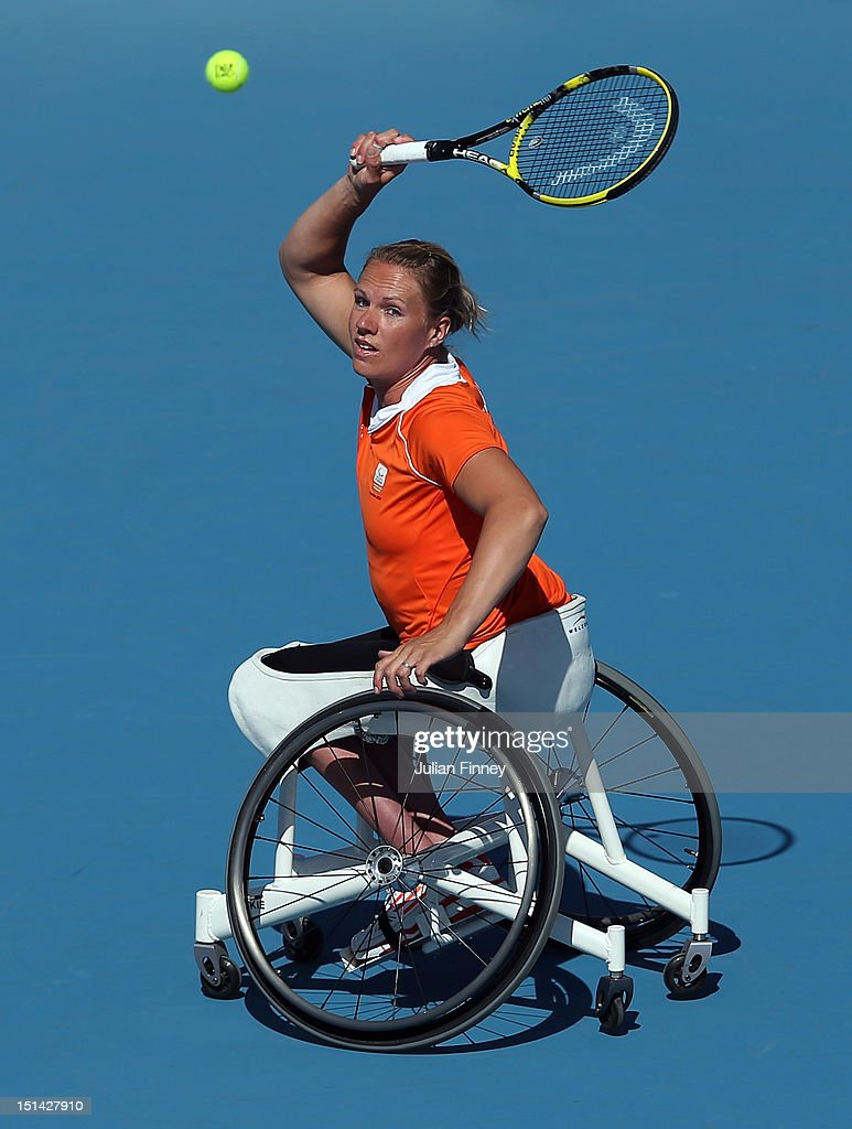 <a gi-track='captionPersonalityLinkClicked' href=/galleries/search?phrase=Esther+Vergeer&family=editorial&specificpeople=622149 ng-click='$event.stopPropagation()'>Esther Vergeer</a> of Netherlands plays a forehand in her match against Aniek Van Koot of Netherlands in the final of the Women's singles match in the Wheelchair Tennis on day 9 of the London 2012 Paralympic Games at Eton Manor on September 7, 2012 in London, England.
